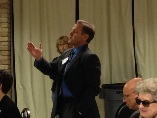 Jerome Puyau speaks in 2015 at a legislative breakfast hosted by Power of Public Education Lafayette.