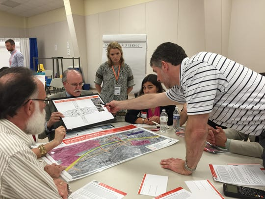 Residents asked questions May 19, 2016, about 19 designs