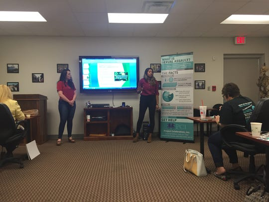 Brittany, left, shares her story at a human trafficking training for service providers in northwest Louisiana.