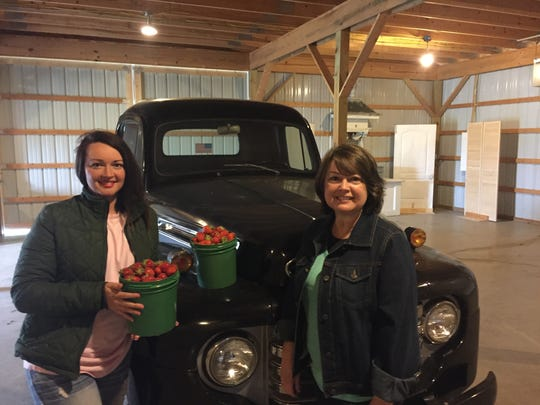 Katie and Lora Black can offer strawberries from their