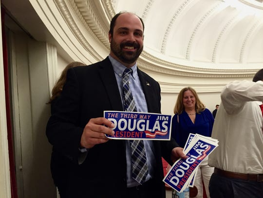 "Sen. Dustin Degree, R-Franklin, holds a ""Jim Douglas for President"" sticker on May 6, 2016, the final day of Vermont's legislative session. Degree has since joined Gov. Phil Scott's administration to lead workforce expansion efforts."