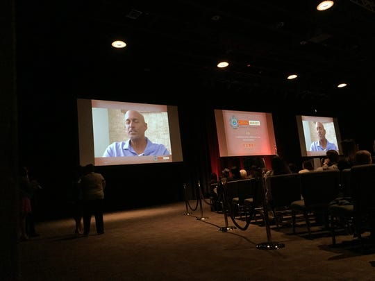 A video of a surivors story plays during the Cardiac Arrest Survivors Ceremony at the TD Convention Center in Greenville. May 20, 2016