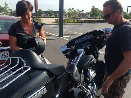 Margot Stolzle, 54, and her partner, Thomas Huf, 51, are motorcycle enthusiasts and say that in their native Germany it is mandatory that helmets are worn all the time. Here they like the fact that they have an option.