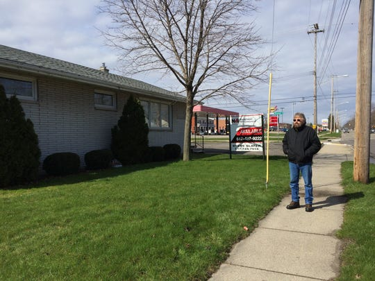 Michael Morofsky, a resident of Colonial Village neighborhood, stands on the sidewalk in front of a building for sale on April 8, 2016. Morofsky heard a rumor that a medical marijuana shop was to open. His suspicions were confirmed when Our Miracle Garden opened in mid-May.