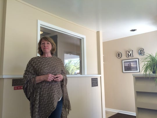 Debbie Robinson, a partner at Our Miracle Garden, a medical marijuana business, talks on May 19, 2016 about improvements to the building made to the property.