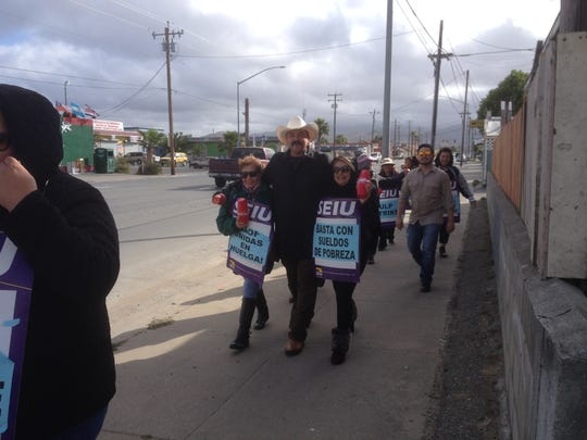 Salinas City Councilman Tony Barrera was one of four local candidates for elected office joining the marchers on Friday morning.