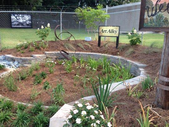 A rain garden to help catch water runoff was created