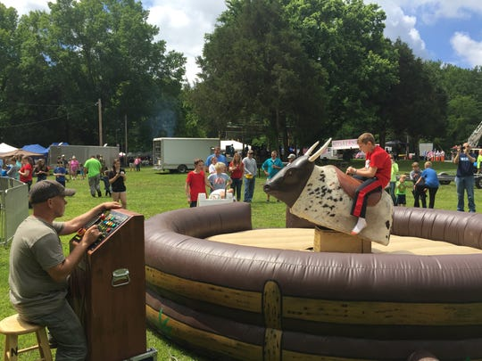 A mechanical bull was a new activity for Eagle Fest visitors.