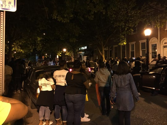 A crowd gathered in the 900 block of Clifford Brown