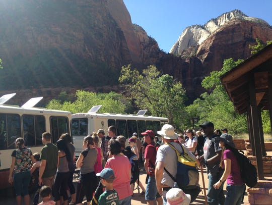 Crowds line up to ride the bus into Zion National Park