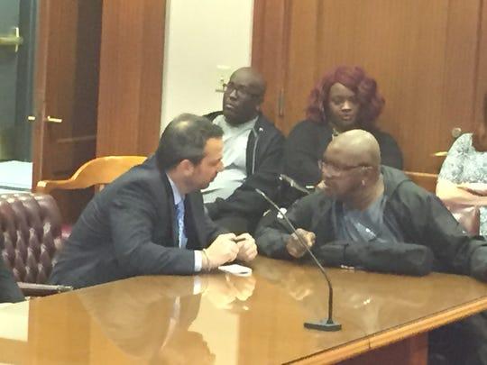Sam Johnson talks with his attorney, Blake Maislin,