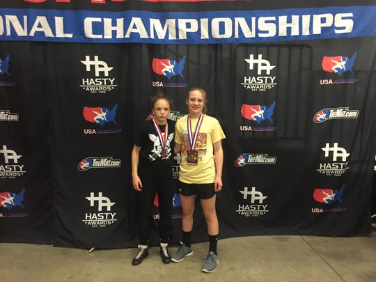 Montana Delawder and Tiffani McNelis pose with their medals at the Body Bar Women's National Championships.