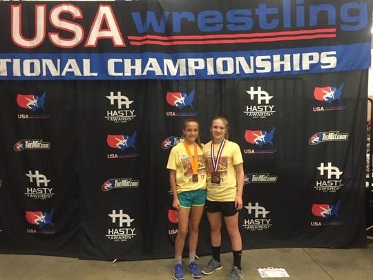 Carly Gross and Tiffani McNelis pose with their medals at the Body Bar Women's National Championships.