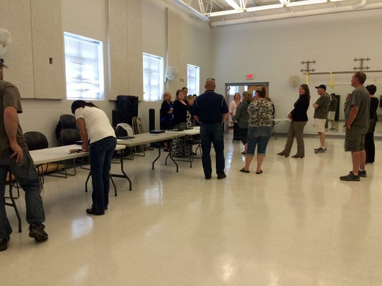 Oakwood Elementary School parents and relatives filled out forms Monday, May 23, 2016, to pick up their children at the Oshkosh YMCA on 20th Avenue. Authorities evacuated the town of Algoma school after office staff received a phone call indicating a threat.