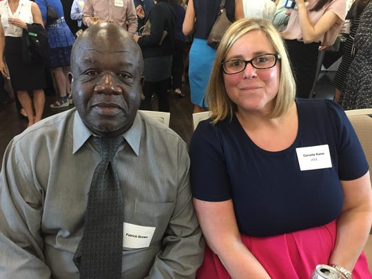 Patrick Brown, executive director of the Greater Burlington Multicultural Resource Center, and Danielle Kane of the Vermont Department of Labor attend the United Way of Northwest Vermont's annual awards celebration Tuesday, May 24, 2016, at St. Michael's College in Colchester.