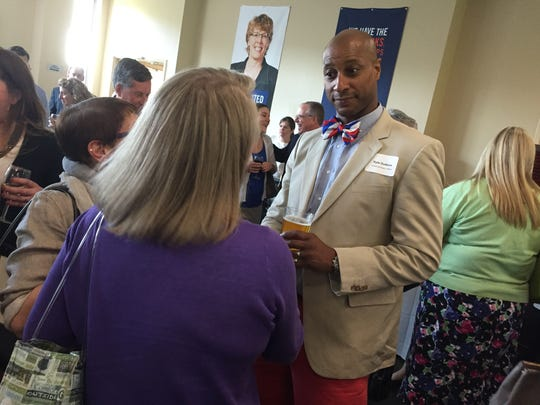 Kyle Dodson, president of the Greater Burlington YMCA, right, visits with other attendees at the United Way of Northwest Vermont's annual awards celebration Tuesday, May 24, 2016, at St. Michael's College in Colchester. Dodson became the YMCA's leader in March.