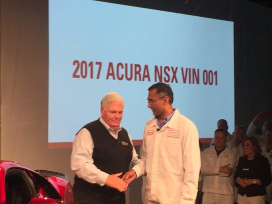 Rick Hendrick, owner of Hendrick Motorsports and chairman of Hendrick Automotive Group, shakes hands with Clement D'Souza, engineering leader of the Acura NSX, after being presented with the very first 2017 Acura NSX.