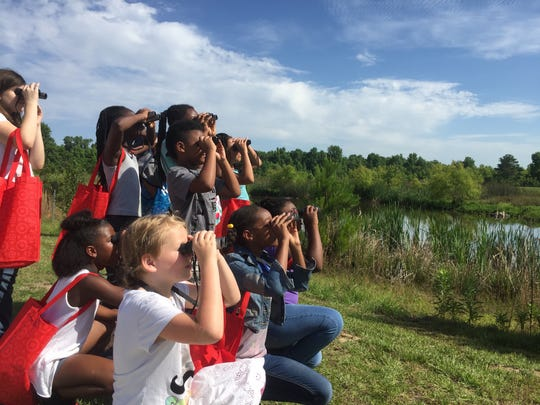 Astoria Park Elementary students watch birds at the Okeeheepkee Prairie Park.