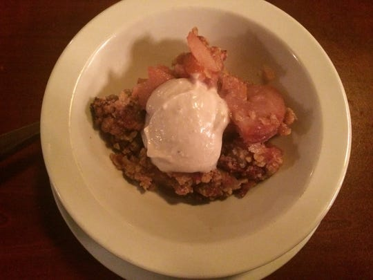 A peach crumble with cashew sauce at Trumpet Blossom