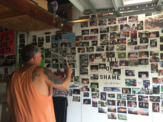 "Barry Baker keeps a ""Wall of Shame"" in his garage to document 20 years of hosting friends for the Indianapolis 500 weekend."