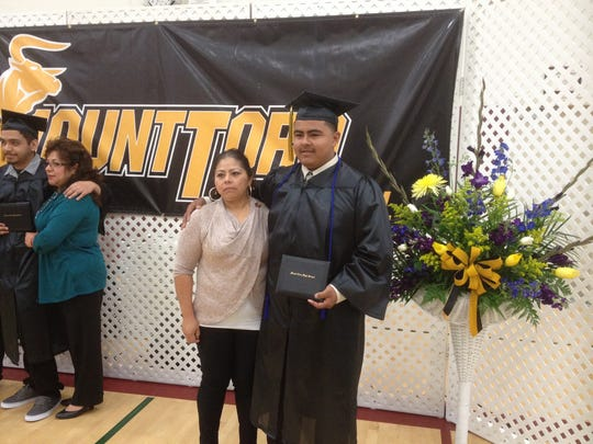 Graduates pose for photos following Thursday's ceremonies.