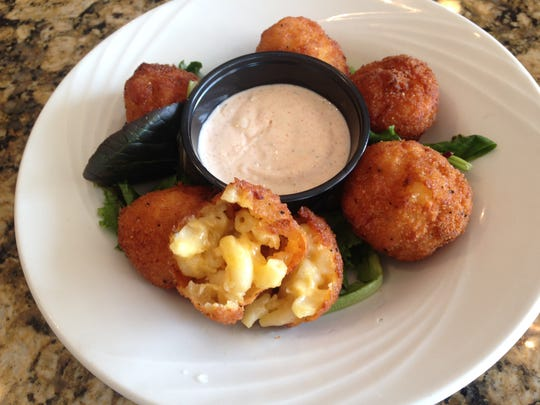 Homemade macaroni and cheese is deep fried as an appetizer