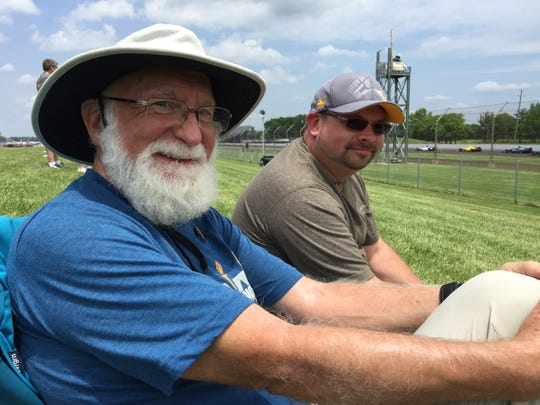 Vancouver, Wash., residents John Weaver, left, and son Scott Weaver enjoy the racing on Carb Day.