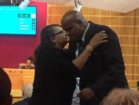 Former Deputy Fire Chief Joe Glover hugs a supporter