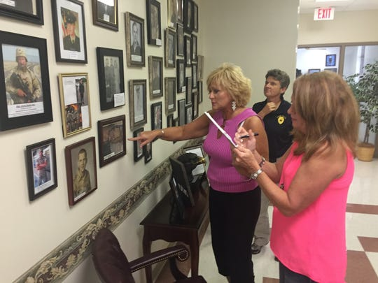 Dover Mayor Lesa Fitzhugh, left, calls off names to