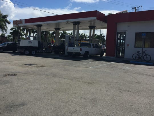 Segfredo Garcia parked his 2001 Lexus at pump No. 3 (white pickup truck) on Wednesday night before being detained by authorities at this Exxon station, located at 1080 W. Hallandale Beach Boulevard in Hallandale Beach.