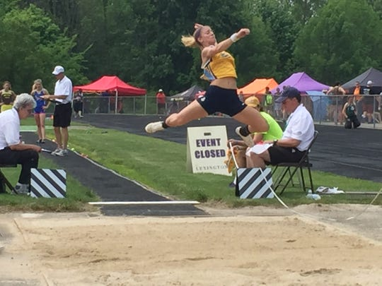 River Valley junior Anna Hopkins competes in the girls long jump at Lexington in the Division II regional track finals Saturday. She finished 10th with a leap of 16-2 1/2.