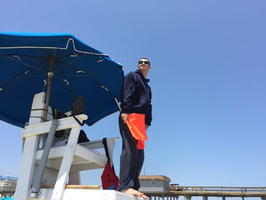 A member of the Ocean City Beach Patrol watches over