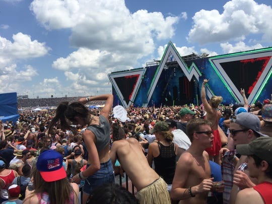 Fans dance to Skrillex in the Snake Pit.