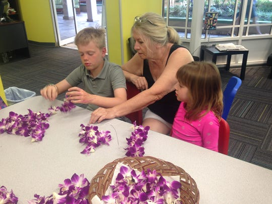 Making leis with Grandma -- and thrilled beyond belief.
