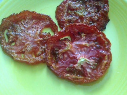 After two hours, oven roasted tomatoes are ready to eat or store in freezer.