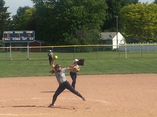 Yale High School pitcher Natalie Keith throws to the