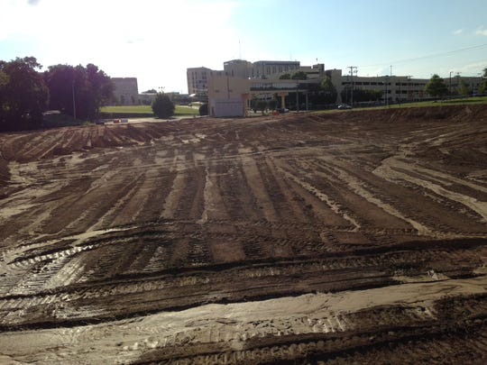 Work begins Wednesday on the West Tennessee Rehabilitation Hospital, at the previous location of the Jackson Clinic on Forest Avenue. The pedestrian walkway can be seen in front of Jackson-Madison County General Hospital.