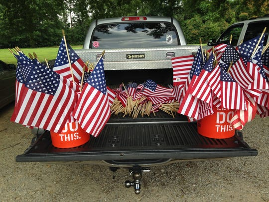 Dozens of American flags from military gravesites at Highland Memorial Gardens were placed in the back of this truck Wednesday.
