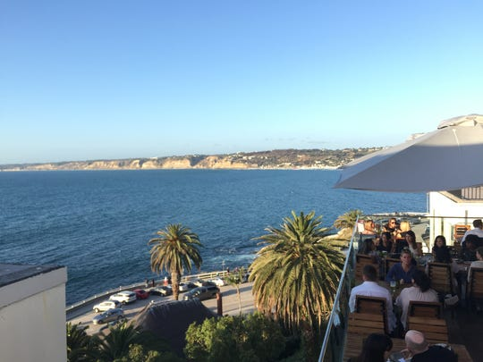 Ask for a seat on the upstairs patio at the new Duke's La Jolla restaurant for this view.