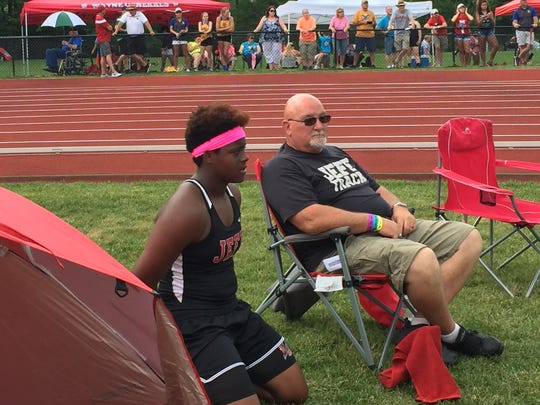 Lafayette Jeff junior Essence Henderson waits with Broncho throws coach Jerry Madlung prior to the discus finals at the state meet. Henderson won the state title with a throw of 151 feet, 1 inch.