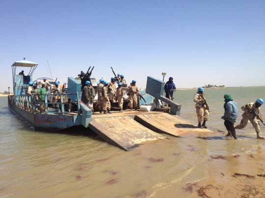 United Nations peacekeepers shown at work on the Niger River.