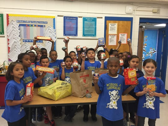 """On June 3, Linden School No. 4 in Linden participated in the Annual LINCS Walk-a-thon. This event taught students the importance of helping others in the community that are in need, according to a school news release. The school's """"family"""" went above and beyond by exceeding expectation by donating more than 1,300 nonperishable food items for this cause. Pictured is Carol Cetroni's second-graders, who collected a total of 316 items."""