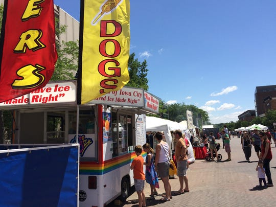 Visitors to the Iowa Arts Festival buy food downtown