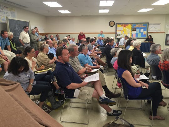 A crowd of people listen during a South Burlington City Council discussion Monday night regarding a lawsuit over the F-35 fighter jet.