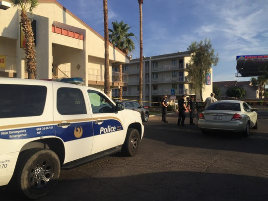 Three men were shot and two killed at a Motel 6 near Interstate 17 and Northern Avenue on June 5, 2016. Police remained at the scene on the morning of June 6.