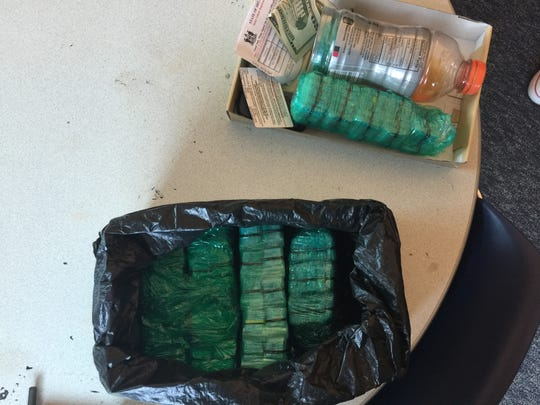 Police netted nearly 3,000 bags of heroin packaged