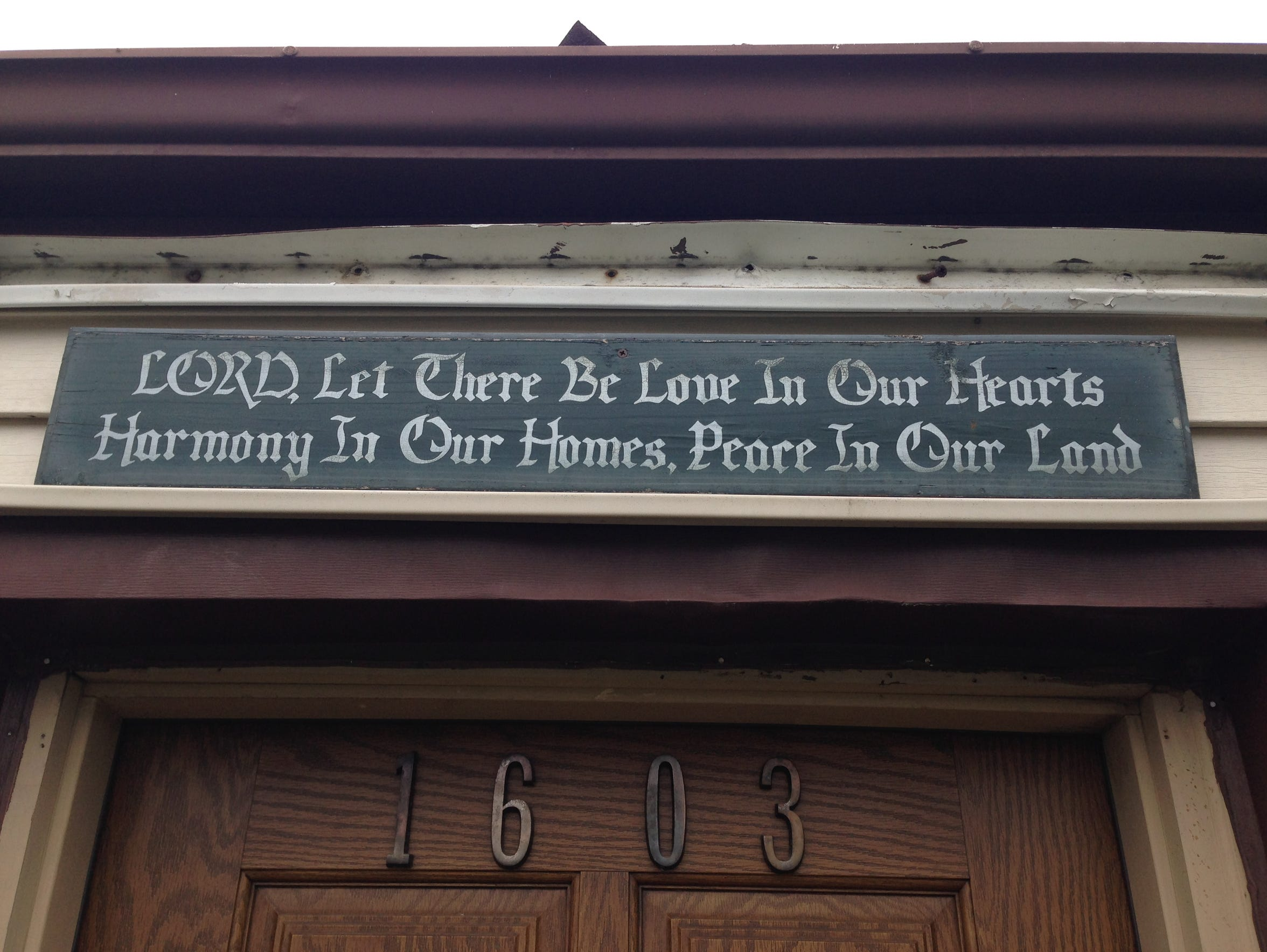 A sign above Lakayla Crumes' front door on Sewell Avenue