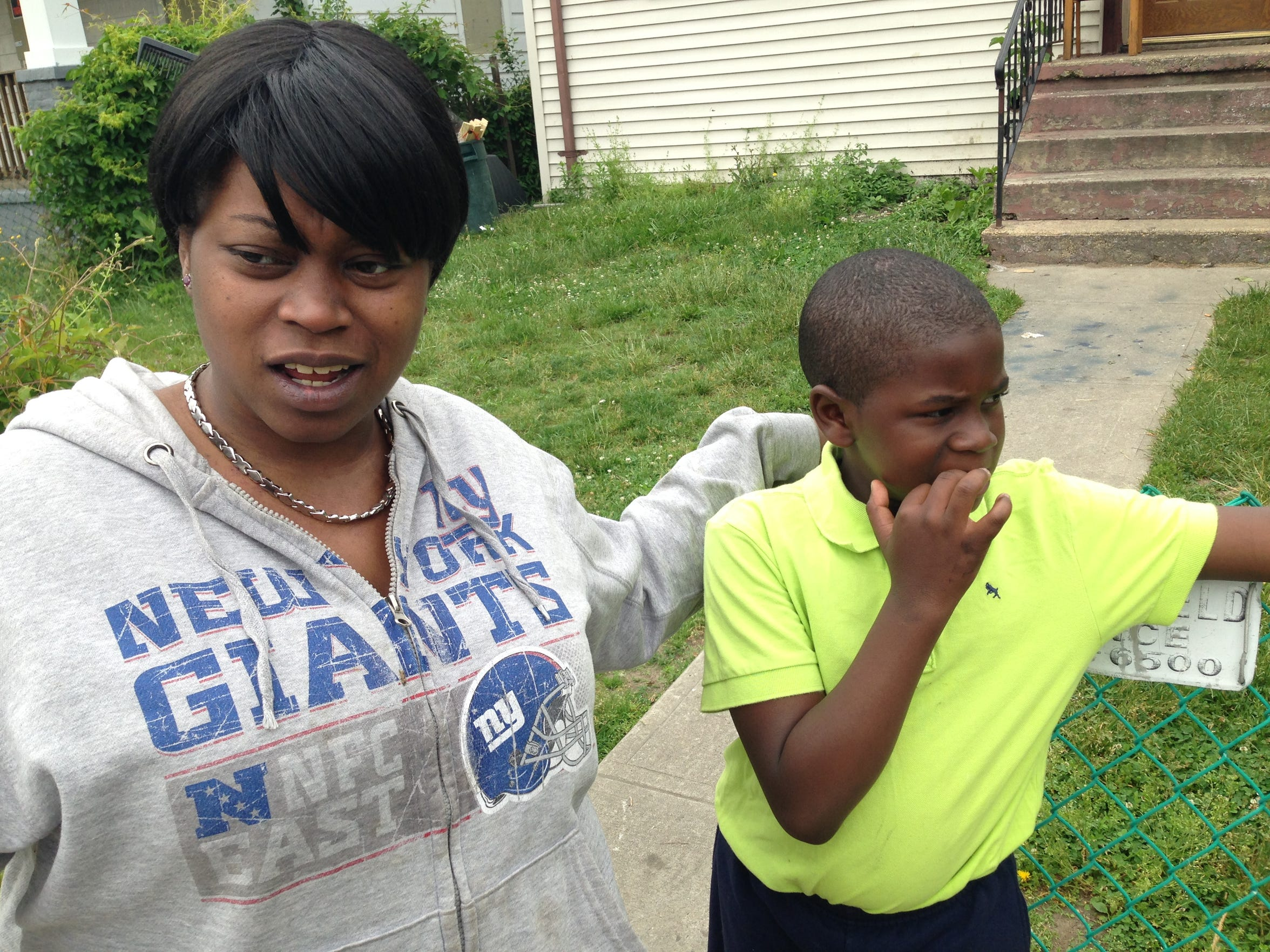 A year later, Sewell Avenue resident Lakayla Crumes, shown with her son, Julius, 9, still struggles with the anger see feels over the killing of Tamara Wilson-Seidle, who was gunned down in front of Crumes' home.
