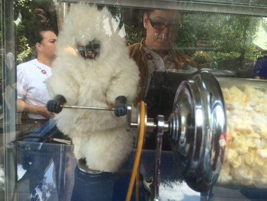 Characters turning the popcorn at carts around Disneyland
