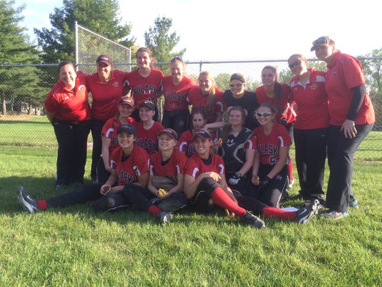 The Pulaski softball team after it won the outright Fox River Classic Conference title on May 19 with a 3-0 victory over Green Bay Southwest. It was the Red Raiders' first conference title since 2009.